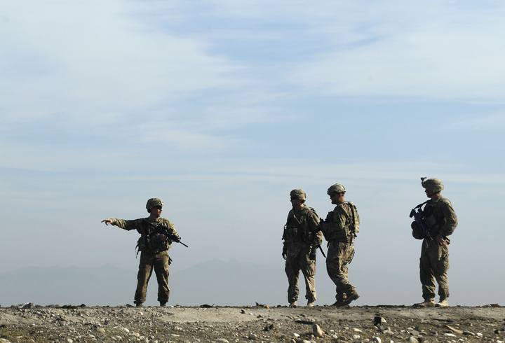 U.S. troops inspect at the site of a suicide attack on the outskirts of Jalalabad