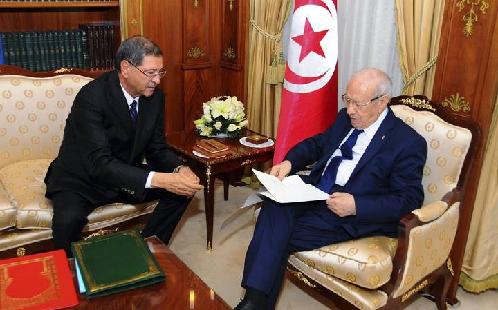 Tunisia's nominated prime minister Habib Essid gives the list of the new government to President Beji Caid Essebsi in Tunis