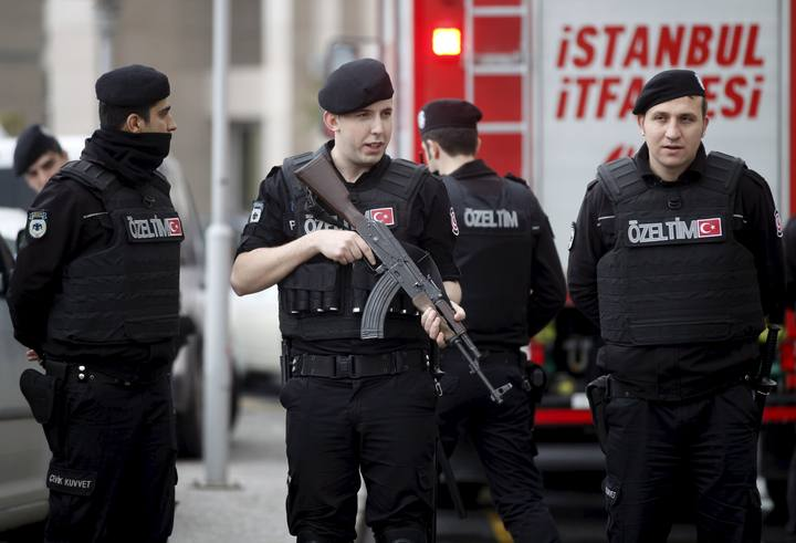 Turkish riot police stand guard in front of the Justice Palace in Istanbul