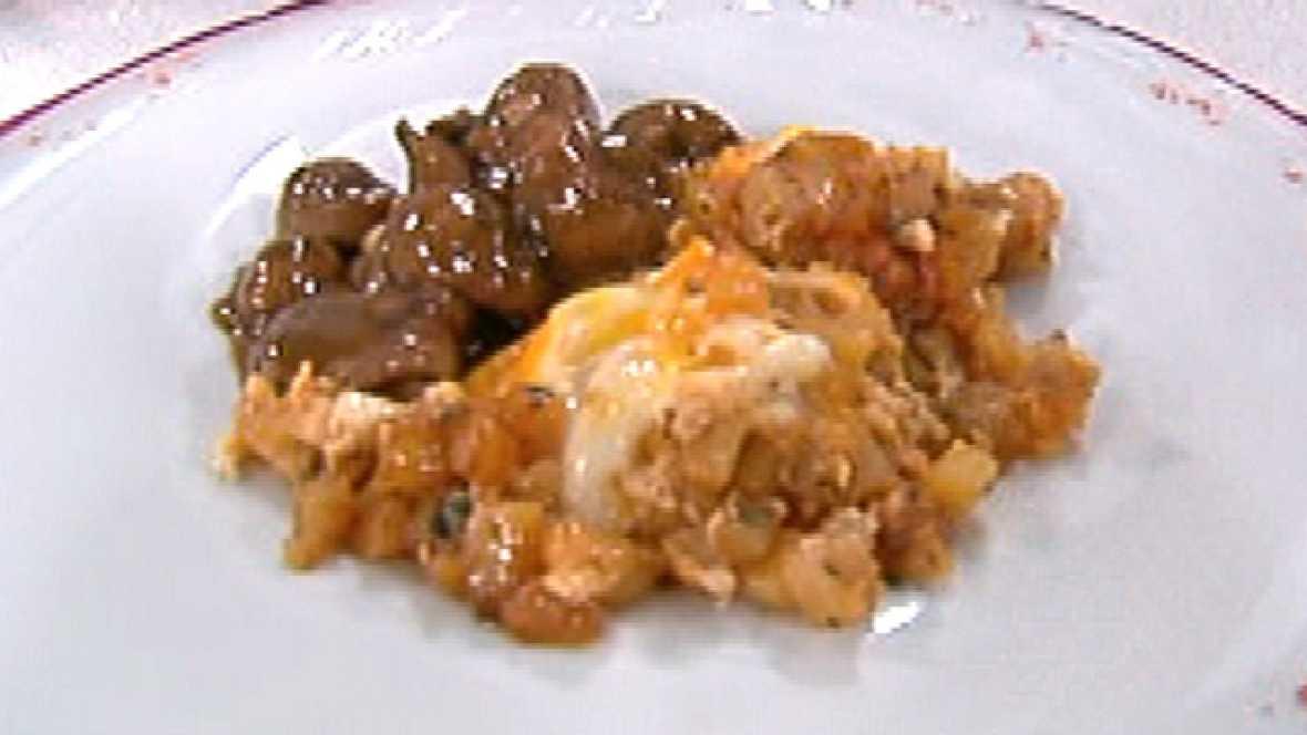 Huevos fritos sobre patatas pochadas picantes (25/10/2011)