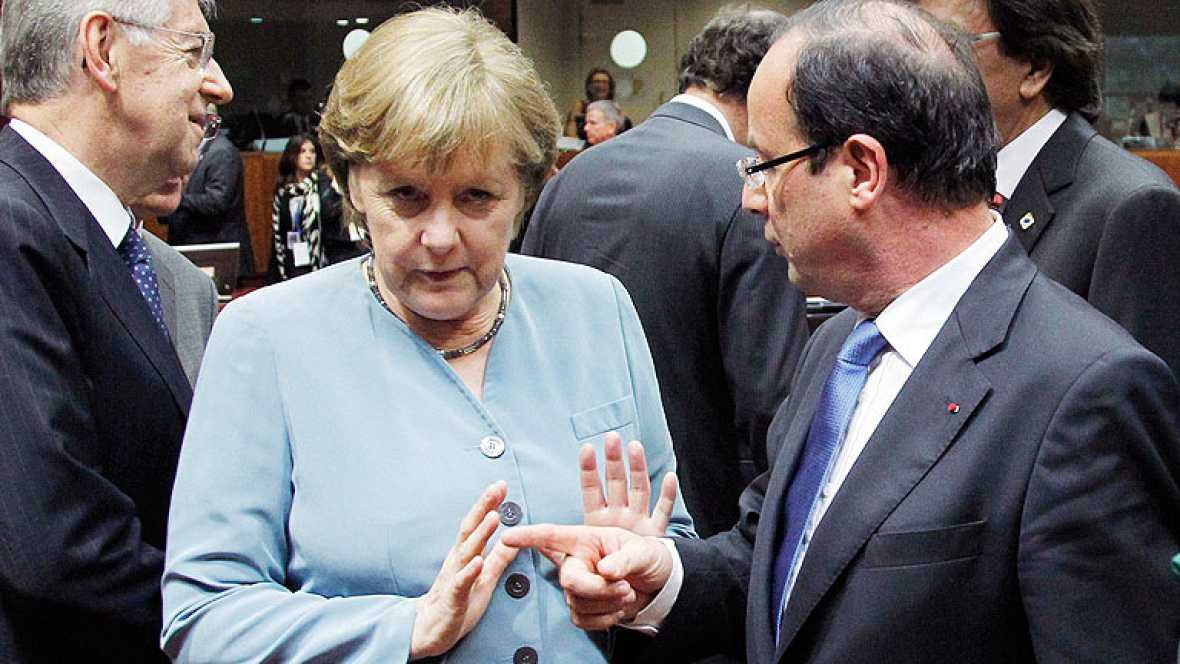 Los eurobonos se interponen entre Merkel y Hollande