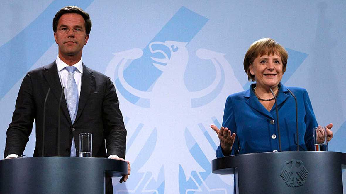 Merkel admite que los fondos de rescate puede comprar deuda en el mercado secundario, pero con condiciones