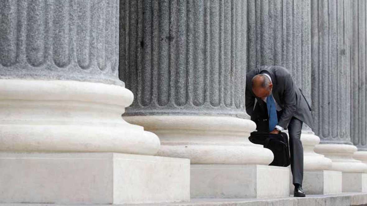 La prima de riesgo baja de 500 puntos y la Bolsa sube por la banca