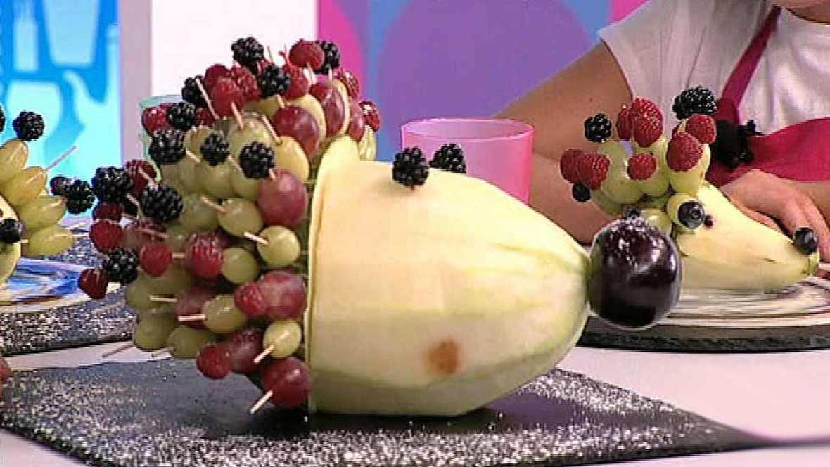Puercoespín de pera con permanente de uvas