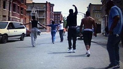 El día a día de Baltimore: un tiroteo en el barrio de Freddie Gray