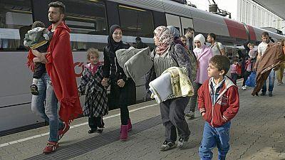 Los voluntarios ayudan en la estación de Viena a los refugiados camino de Alemania
