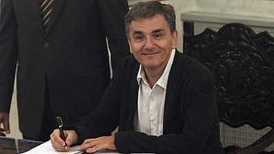 Tsakalotos firmó el tercer rescate a Grecia y será el responsable de aplicarlo