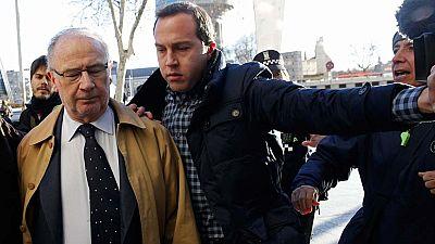 Varios preferentistas increpan a Rodrigo Rato a su llegada a los juzgados de Plaza de Castilla