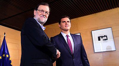 Rajoy se compromete con Rivera a fijar hoy la fecha de investidura y a firmar el pacto anticorrupción