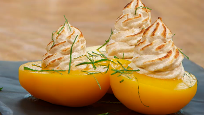 Receta de melocotones en alm�bar con merengue de coco