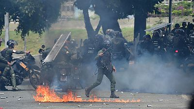Una marcha de la oposición en Caracas desemboca en enfrentamientos con las fuerzas de seguridad